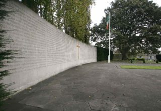 Left side of Arbour Hill memorial showing curved wall of Wicklow Ardbraccan limestone and hand carved lettering by Michael Biggs of the 1916 proclamation.