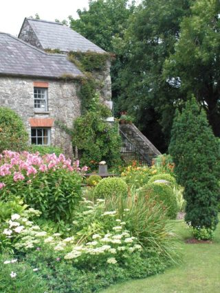 Garden in front of the cottage at Barryscourt Castle
