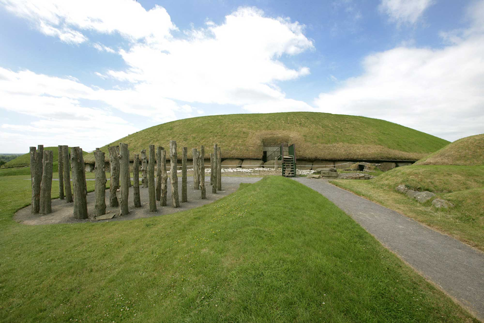 Eastern view of Knowth Mound with reconstructed timber circle.