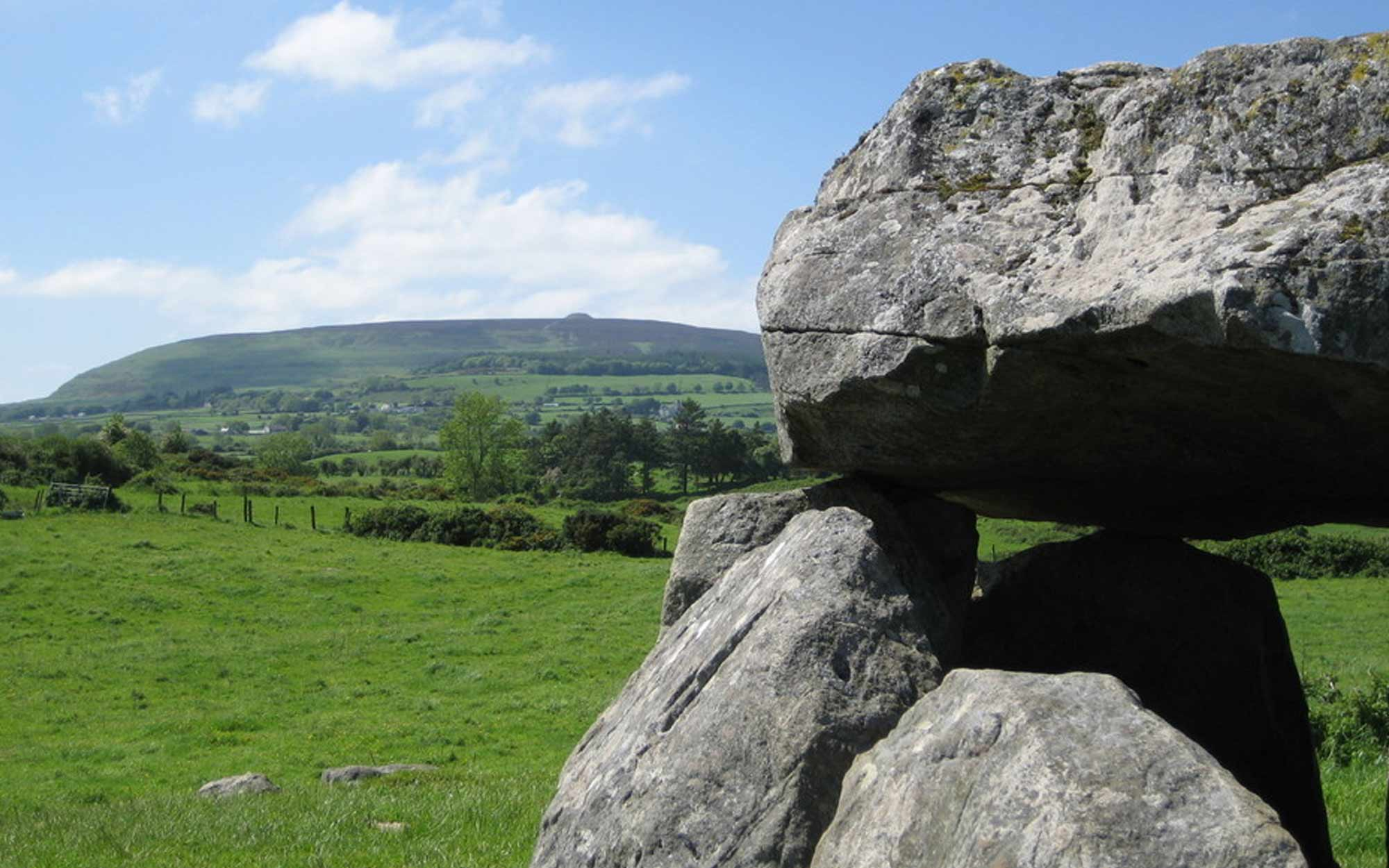 Carrowmore Monument 7 with Queen Maeve's Cairn on Knocknarea in background