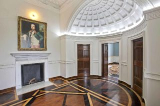 Casino Marino entrance hall with painting of James Caulfeild hanging on wall