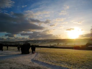 The sun rising over Red Mountain Donore on a cold morning.