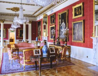 View of paintings and chandeliers hanging in the Dublin Castle State Drawing room