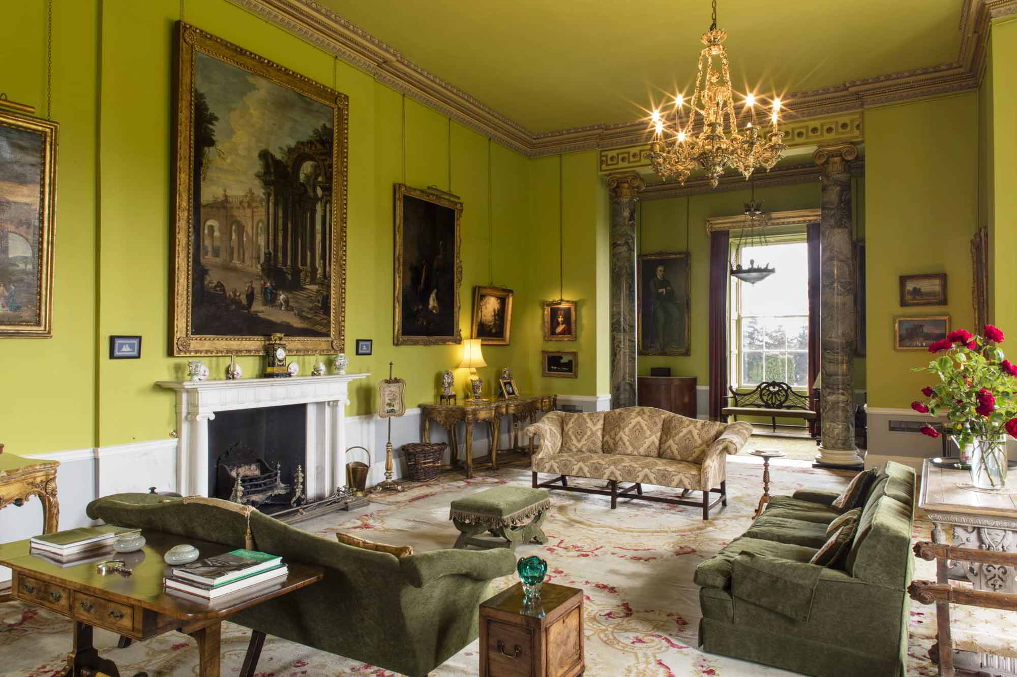 The drawing room with Irish yew settee in front of window.