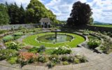 Overall view of the sunken garden where circular terraces descend down to the elliptical pool with the fountain
