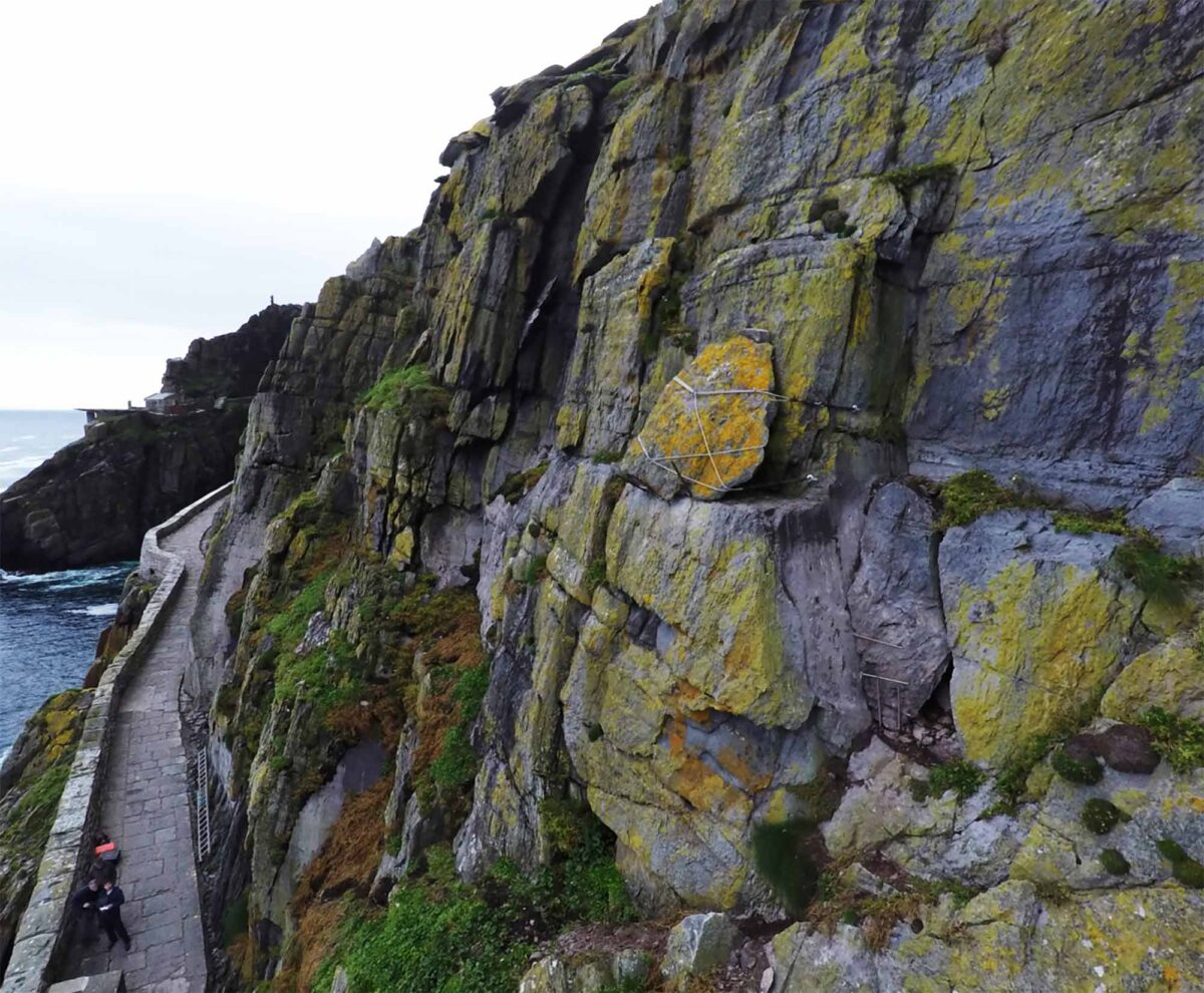 Work carried out by OPW staff in 2016 to securely moor with steel cables a large rock positioned over the Lighthouse Road