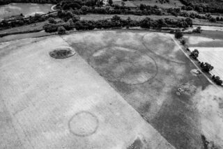 High-contrast image of the henge complex near the mound known as Site B (top left), showing as differential growth in grassland.