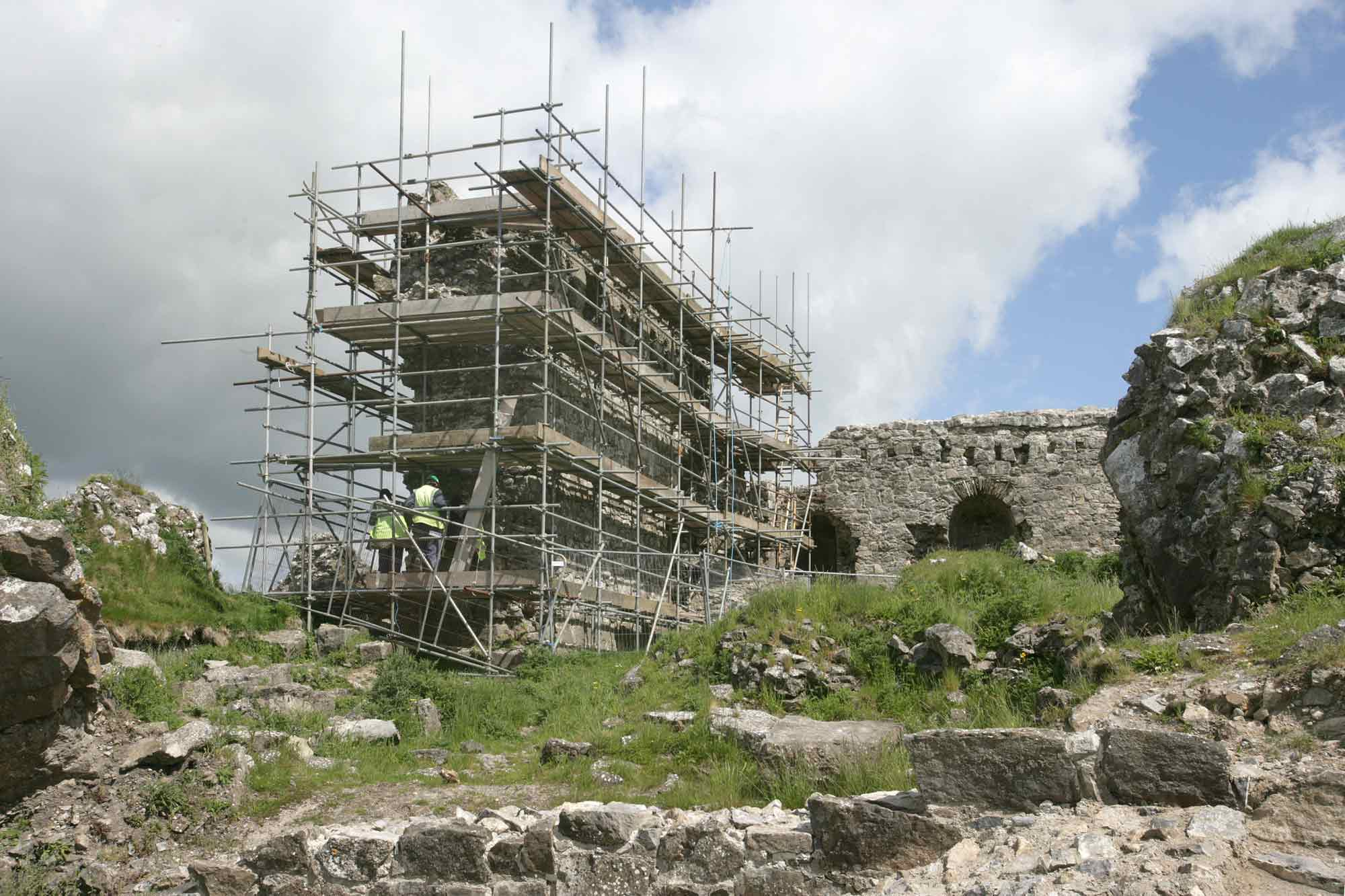 Conservation taking place on the Rock of Dunamase with scaffolding in place.