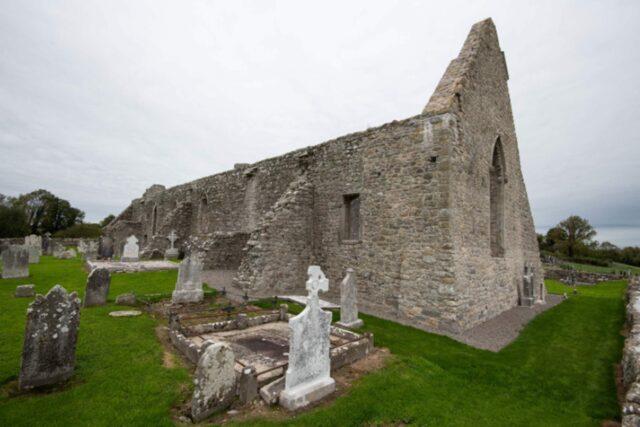 Drumlane Abbey with gravestones