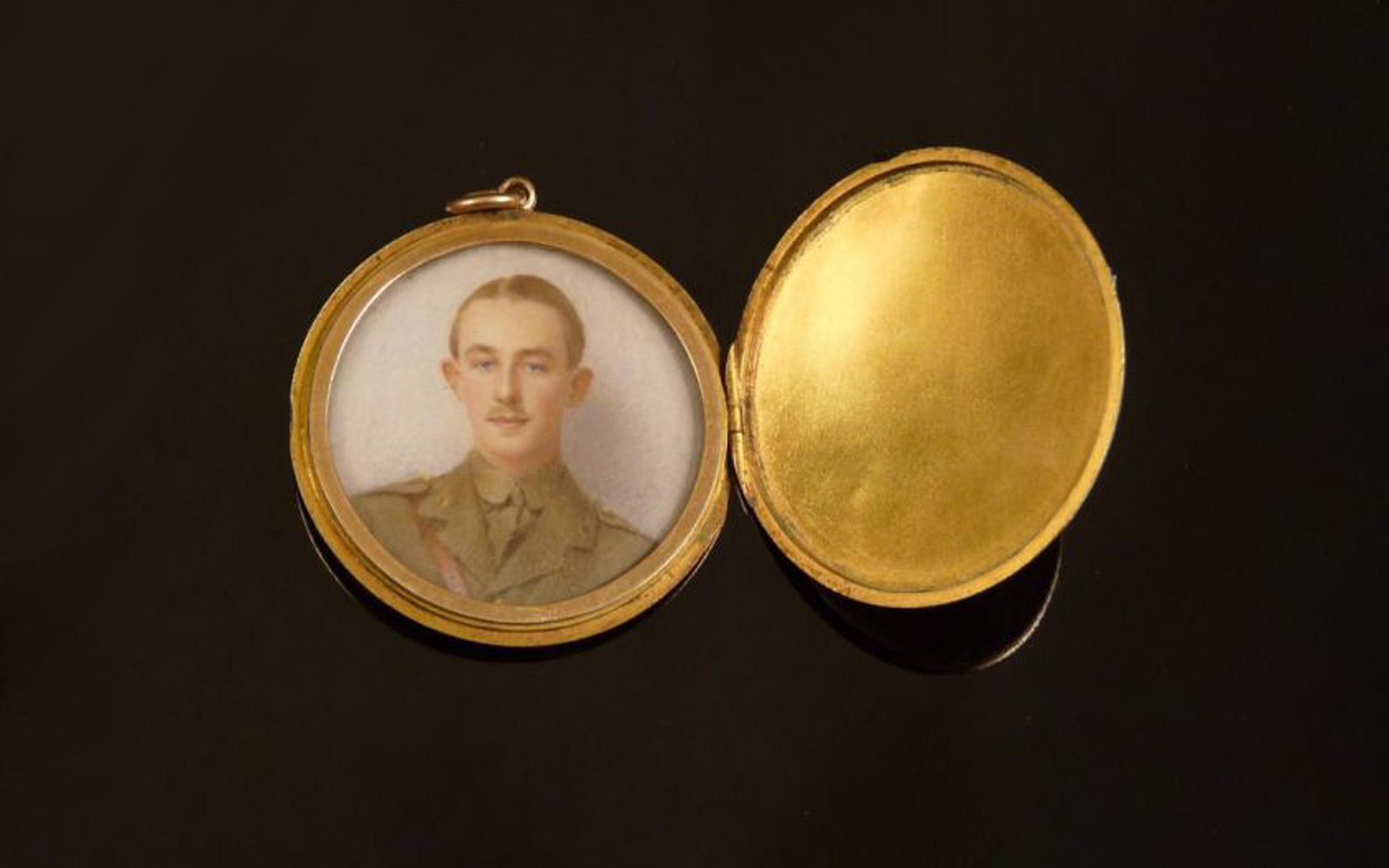 An Edwardian gold locket holding an image of Guy Vickery Pinfield of Bishops Stortford, who was commissioned as a second lieutenant into the 8th King's Royal Irish Hussars in August 1914. He was killed aged 21 in the Easter Rising in Dublin. Photograph: Sworders Fine Art Auctioneers