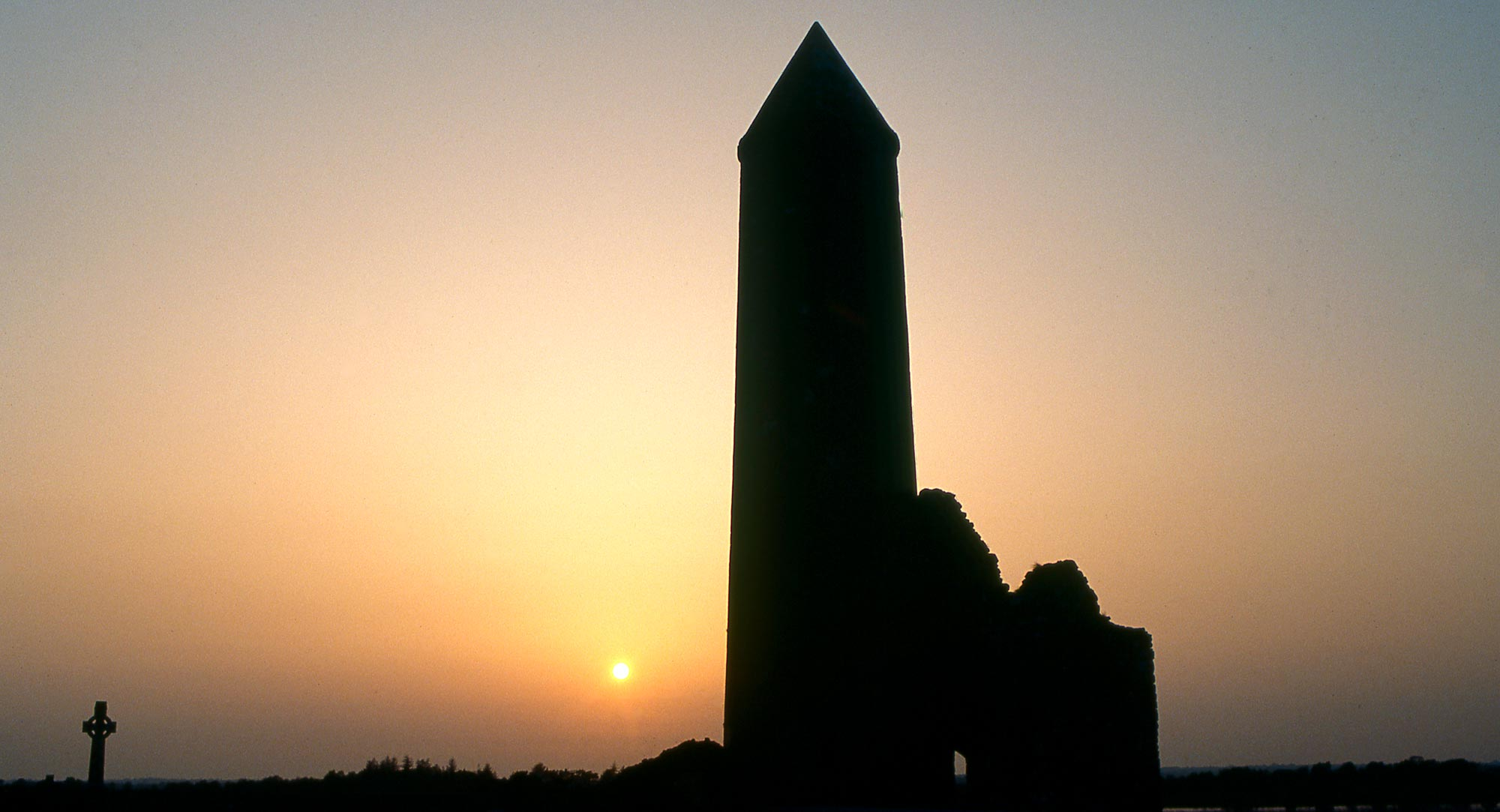 Silhouette of the round tower at Clonmacnoise