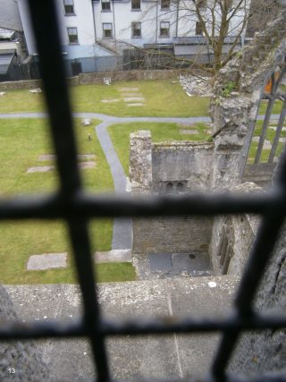View south from slit window in spiral staircase overlooking part of the south transept & our graveyard